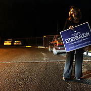 Elizabeth Redenbaugh, candidate for NC Senate District 9, holds a sign outside of Mosley Performance Learning Center Tuesday November 4, 2014 in Wilmington, N.C. (Jason A. Frizzelle)