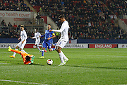 Ruben Loftus-Cheek goes around Scuffet Simone during the U19 International match between England U19's and Italy U19's at the New York Stadium, Rotherham, England on 14 November 2014.