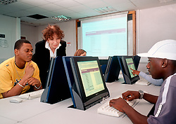 Students on business course learning the use of spreadsheets, UK