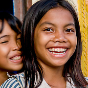 Young cambodian girls laughing (Kampong Cham, Cambodia - Oct. 2008) (Image ID: 081025-1722091a)