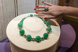 "© Licensed to London News Pictures. 29/06/2017. London, UK.  A staff member presents an ""Imperial Jade Beads"" necklace, the largest jade beads necklace known to date.  Members of the public visit Masterpiece London, a leading art fair held in the grounds of the Royal Hospital Chelsea.  The fair brings together 150 international exhibitors presenting works from antiquity to the present day and runs 29 June to 5 July 2017.  Photo credit : Stephen Chung/LNP"