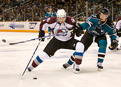 April 16, 2010; San Jose, CA, USA; Colorado Avalanche center Matt Duchene (left) controls the puck in front of San Jose Sharks left wing Dany Heatley (15) during the third period of game two in the first round of the 2010 Stanley Cup Playoffs at HP Pavilion.  The Sharks defeated the Avalanche 6-5 in overtime. Mandatory Credit: Jason O. Watson / US PRESSWIRE