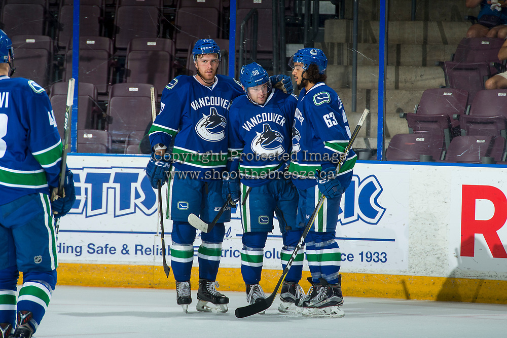 PENTICTON, CANADA - SEPTEMBER 11: Brett McKenzie #77 and Jalen Chatfield #63 congratulate Michael Carone #58 of Vancouver Canucks on his second goal of the first period against the Edmonton Oilers on September 11, 2017 at the South Okanagan Event Centre in Penticton, British Columbia, Canada.  (Photo by Marissa Baecker/Shoot the Breeze)  *** Local Caption ***