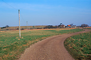 A912Y3 Telephone poles and wires crossing countryside Butley Suffolk England
