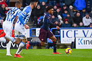 Alex Iwobi of Arsenal (17) attacks forward during the Premier League match between Huddersfield Town and Arsenal at the John Smiths Stadium, Huddersfield, England on 9 February 2019.