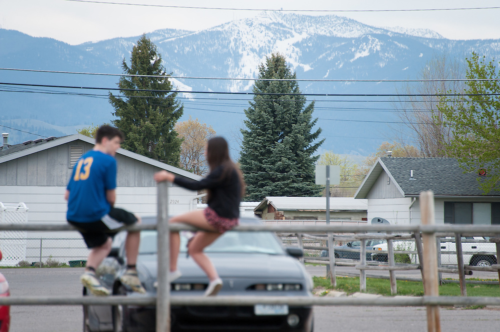 Two teenage students and friends of Diren Dede, a German exchange student, wait in the parking lot at the soccer fields of Fort Missoula in advance of Dede's vigil.