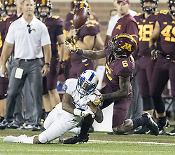 August 31, 2017 - Minneapolis, MN, USA - Minnesota wide receiver Tyler Johnson (6) misses a pass intended for him as he is tackled by Buffalo cornerback Cameron Lewis during the fourth quarter at TCF Bank Stadium in Minneapolis on Thursday, Aug. 31, 2017. The host Golden Gophers won, 17-7. (Credit Image: © Elizabeth Flores/TNS via ZUMA Wire)