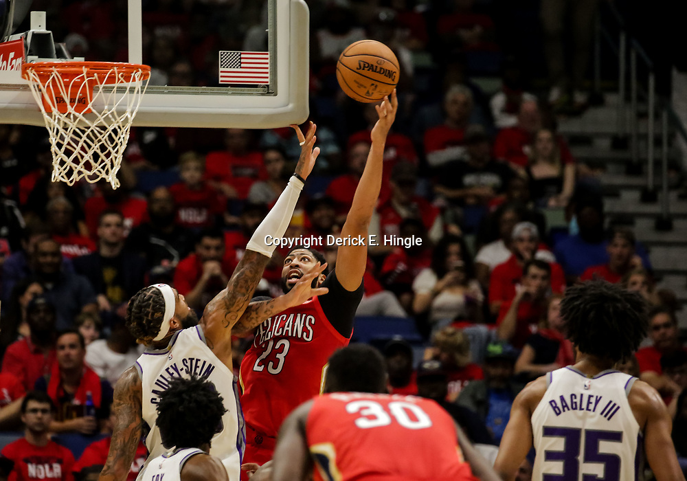 Oct 19, 2018; New Orleans, LA, USA; New Orleans Pelicans forward Anthony Davis (23) shoots over Sacramento Kings center Willie Cauley-Stein (00) during the second quarter at the Smoothie King Center. Mandatory Credit: Derick E. Hingle-USA TODAY Sports