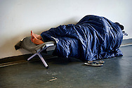 A guest refugee sleeps of the Temporary accommodation center for immigrants in Athens, at Olimpico hockey in the area Elliniko 10 Febraury 2016.<br />