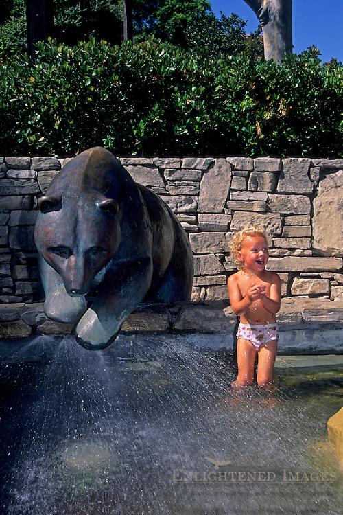 Child playing in fountain at Mission Plaza, San Luis Obispo, CALIFORNIA