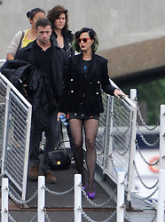 Singer Katy Perry seen boarding a ferry on the Thames from the Savoy pier in London, heading to the O2 Greenwich. Katy with green hair and bright orange sunglasses wore a short mini dress, with a black jacket, tights and purple high heel shoes. London, UK. 30/05/2014<br />