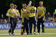 Hampshire T20 all rounder Shahid Afridi is congratulated by his team mates after his caught and bowled to dismiss John Simpson during the NatWest T20 Blast South Group match between Middlesex County Cricket Club and Hampshire County Cricket Club at Uxbridge Cricket Ground, Uxbridge, United Kingdom on 27 May 2016. Photo by David Vokes.