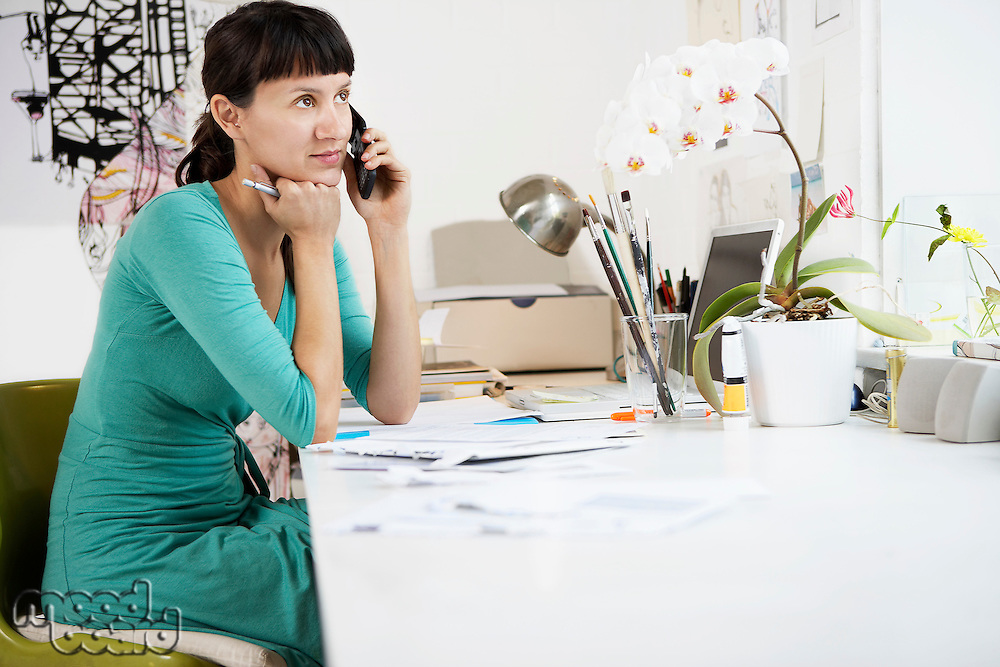 Businesswoman daydreaming on Cell Phone