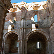 The great Abbey of San Galgano was built between 1220 and 1268, when in Italy the Romanesque style merged with the rising French Gothic style import