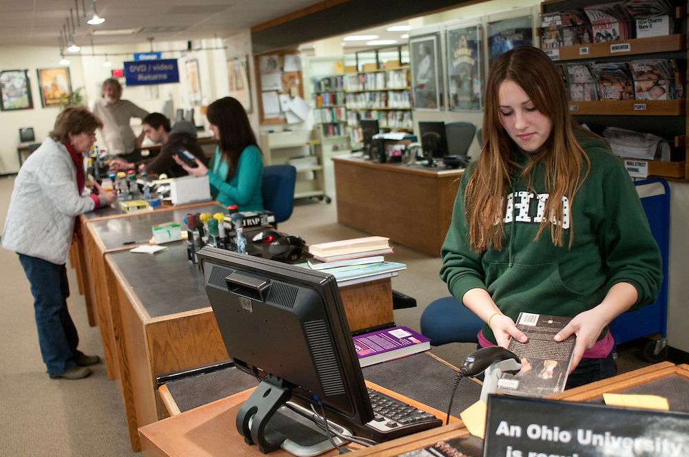 Suzy Goralske, an undecided freshman, works at the circulation desk checking in books on Tuesday afternoon, February 22, 2011 on the fourth floor of Alden Library.