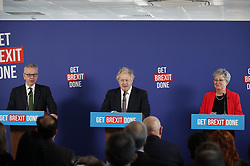 © Licensed to London News Pictures. 29/11/2019. London, UK. Prime Minister Boris Johnson answers questions at a press conference in London with Michael Gove and former Labour MP Gisela Stuart. Later a seven way TV election debate will take place with senior politicians in Cardiff. Photo credit: Peter Macdiarmid/LNP