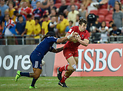 Canada's Matt Mullins breaks past USA's Maka Unufe during the HSBC World Rugby Sevens Series, Singapore, Cup Final match USA -V- Canada  at The National Stadium, Singapore on Sunday, April 16, 2017. (Steve Flynn/Image of Sport)