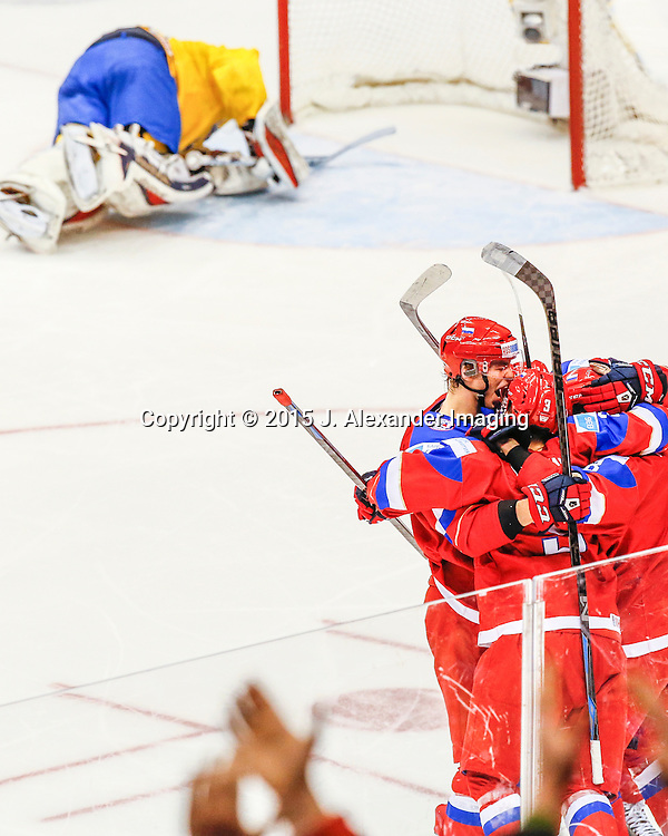 Team Russia players and fans celebrate a goal against Team Sweden during the 2015 IIHF Junior World Championships.