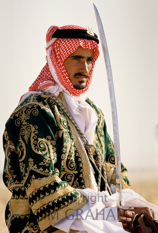 Bedouin on horseback in the desert in Saudi Arabia