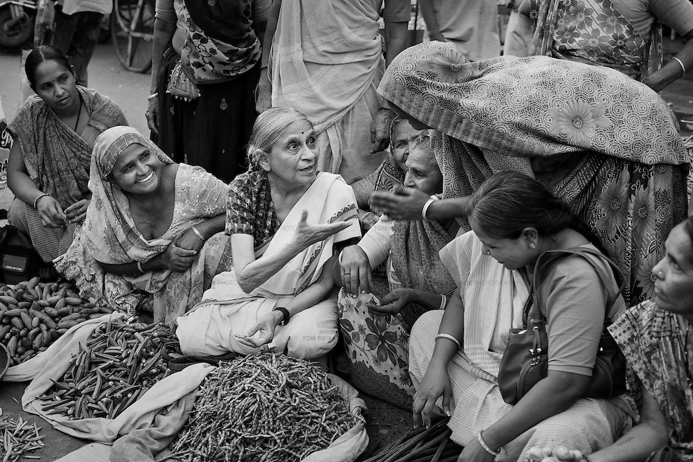Ela Bhatt founder of SEWA (Self Employed Women's Association of India) and a member of The Elders meets SEWA vegetable vendors in the Danapith area of Ahmedabad's old city. Uniting under the banner of SEWA over 30 years ago, these women no longer have to bribe the police or corporation officials in order to keep their stalls. A court order protects their trade and the SEWA bank has allowed them to escape the exploitation of money lenders. ..Photo: Tom Pietrasik.Gujarat, India.February 25th 2010  Mabel van Oranje, CEO of The Elders on a visit to meet members of SEWA (Self Employed Women's Association of India) who work in the salt pan industry in the village of Halvad...Photo: Tom Pietrasik.Gujarat, India.February 25th 2010