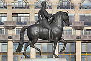 Bronze equestrian statue of King Henri IV of France, at the end of the Pont Neuf, Paris, France. The statue was erected on the death of the King in 1610, although the original was melted down during the French Revolution and replaced with this copy in 1818. In the background is the La Samaritaine department store, first opened 1869, built by Frantz Jourdain and Henri Sauvage, on the Quai du Louvre. It was constructed and reworked 1883-1933 in Art Nouveau and Art Deco style, and its glass roof and Art Deco facade were listed as a UNESCO World Heritage Propery in 1990, as part of the Banks of the Seine. Picture by Manuel Cohen
