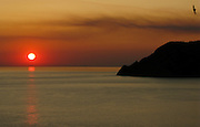 Sunset and smoke from a forest fire above Corniglia, Cinque Terre, Italy