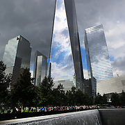 The One World Trade Center stands over the National September 11 Memorial in Downtown Manhattan, New York City, USA. 16th September 2014. Photo Tim Clayton