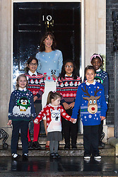 © Licensed to London News Pictures. 12/12/2014. London, UK. The Prime Minister's wife, Samantha Cameron wearing a Christmas jumper with school children outside 10 Downing Street in London for Save the Children's Christmas jumper campaign today. Photo credit : Vickie Flores/LNP