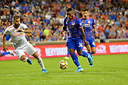 Joseph-Claude Gyau (36) of FC Cincinnati moves the ball upfield past Leandro Gonzalez Pirez (5) of Atlanta United FC during a MLS soccer game, Wednesday, September 18, 2019, in Cincinnati, OH. Atlanta defeated Cincinnati 2-0. (Jason Whitman/Image of Sport)