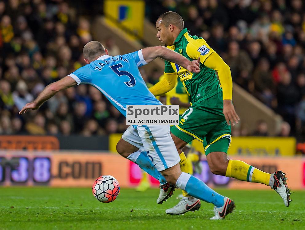 Norwich City midfielder Vadis Odjidja-Ofoe (32) tries to get past Manchester City defender Pablo Zabaleta (5)