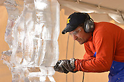Chef Michael Fiala practices ice carving during a training session held on the Risman Plaza