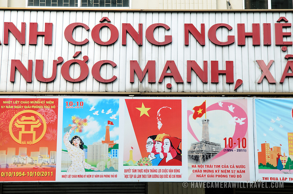 Signs advertising several commemorations in Hanoi and Vietnamese history on a building in the Hoan Kiem distict of Hanoi, Vietnam.