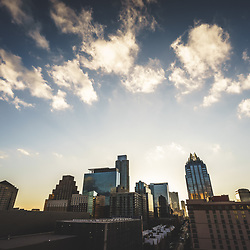 Austin Texas downtown buildings photo with a partially cloudy sky at dusk. Austin, TX is a major city in the Southwestern United States of America. Picture was taken in 2016.