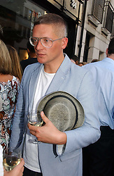 GILES DEACON at an exhibition of photographs by David Montgomery entitled 'Shutterbug' held at Scream, 34 Bruton Street, London W1 on 13th July 2006.<br />