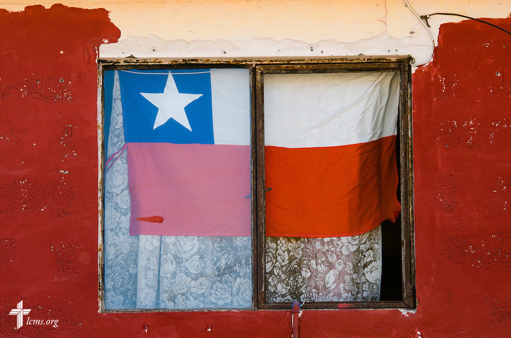 A Chilean flag is displayed in the window of a damaged building  on Wednesday, April 23, 2014, in Alto Hospicio, Chile.  A magnitude 8.2 earthquake struck on April 1, 2014 approximately 95km northwest of Iquique. It condemned several thousand homes and severely damaged more than 10,000 others. LCMS Communications/Erik M. Lunsford