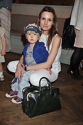 DAISY BATES and her son WOODY at a tea party to celebrate the launch of the limited edition Heart & Sole shoe collection by Step2wo in aid of the British Heart Foundation's Mending Broken Hearts Appeal, held at Aubaine on 2, Selfridge's, Oxford Street, London on 4th July 2012.
