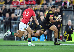 """Vince Aso of the Hurricanes, right, runs from Jonathan Joseph of the Lions in the International rugby match between the the Super Rugby Hurricanes and British and Irish Lions at Westpac Stadium, Wellington, New Zealand, Tuesday, June 27, 2017. Credit:SNPA / Ross Setford  **NO ARCHIVING"""""""
