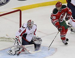 Mar 18; Newark, NJ, USA; Washington Capitals goalie Michal Neuvirth (30) makes a save on New Jersey Devils center Travis Zajac (19) during the first period at the Prudential Center.