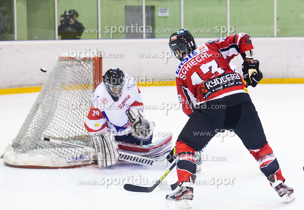 ROBERT KRISTAN of Slovenia vs Michael Schiechl of Austria during Friendly Ice-hockey match between National teams of Slovenia and Austria on April 19, 2013 in Ice Arena Tabor, Maribor, Slovenia.  Slovenia defeated Austria 5-2. (Photo By Vid Ponikvar / Sportida)