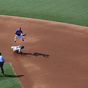 Chris Owings,  Arizona Diamondbacks, steals second base as short stop Ruben Tejada, New York Mets, takes evasive action during the New York Mets Vs Arizona Diamondbacks MLB regular season baseball game at Citi Field, Queens, New York. USA. 11th July 2015. Photo Tim Clayton