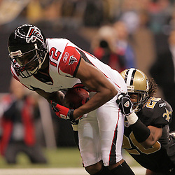 2008 December, 07: Atlanta Falcons wide receiver Michael Jenkins (12) is tackled by New Orleans Saints cornerback Usama Young (28) during a 29-25 victory by the New Orleans Saints over NFC South divisional rivals the Atlanta Falcons at the Louisiana Superdome in New Orleans, LA.
