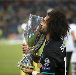 August 8, 2017 - Skopje, Macedonia - Real Madrid's Spanish defender Marcelo kiss his trophy after winning the UEFA Super Cup football match between Real Madrid and Manchester United on August 8, 2017, at the Philip II Arena in Skopje. (Credit Image: © Raddad Jebarah/NurPhoto via ZUMA Press)