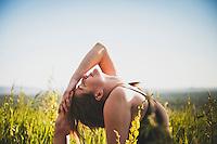 Amanda Fox welcomes a beautiful spring morning by practicing yoga at Chatauqua Park, Boulder, Colorado.