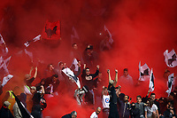 Fans of OGC Nice cheer and light flares during the French championship L1 football match between Nice and Paris Saint Germain on April 18, 2015 at the Allianz Riviera stadium in Nice, France. <br /> Photo: Manuel Blondeau / AOP Press/ DPPI