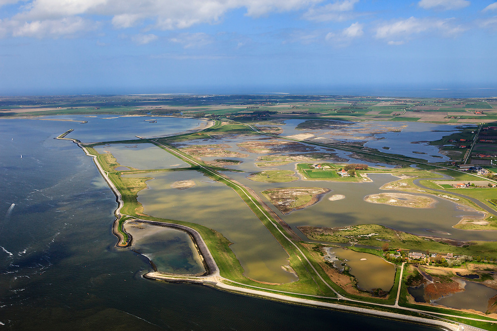 Nederland, Zeeland, Oosterschelde, 09-05-2013; inlagen ten zuiden van Serooskerke. Landinwaarts zijn polders onder water gezet in het kader van Plan Tuureluur. Nationaal Park De Oosterschelde. Nationaal Park De Oosterschelde<br /> Land between the inner (original) dike and the sea dike near Serooskerke. Inland polders are inundated under the nature development project Tureluur. Oosterschelde left.<br /> aerial photo (additional fee required);<br /> copyright foto/photo Siebe Swart.