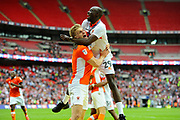 Brad Potts (8) of Blackpool celebrates with Sanmi Odelusi (29) of Blackpool the 2-1 win over Exeter during the EFL Sky Bet League 2 play off final match between Blackpool and Exeter City at Wembley Stadium, London, England on 28 May 2017. Photo by Graham Hunt.