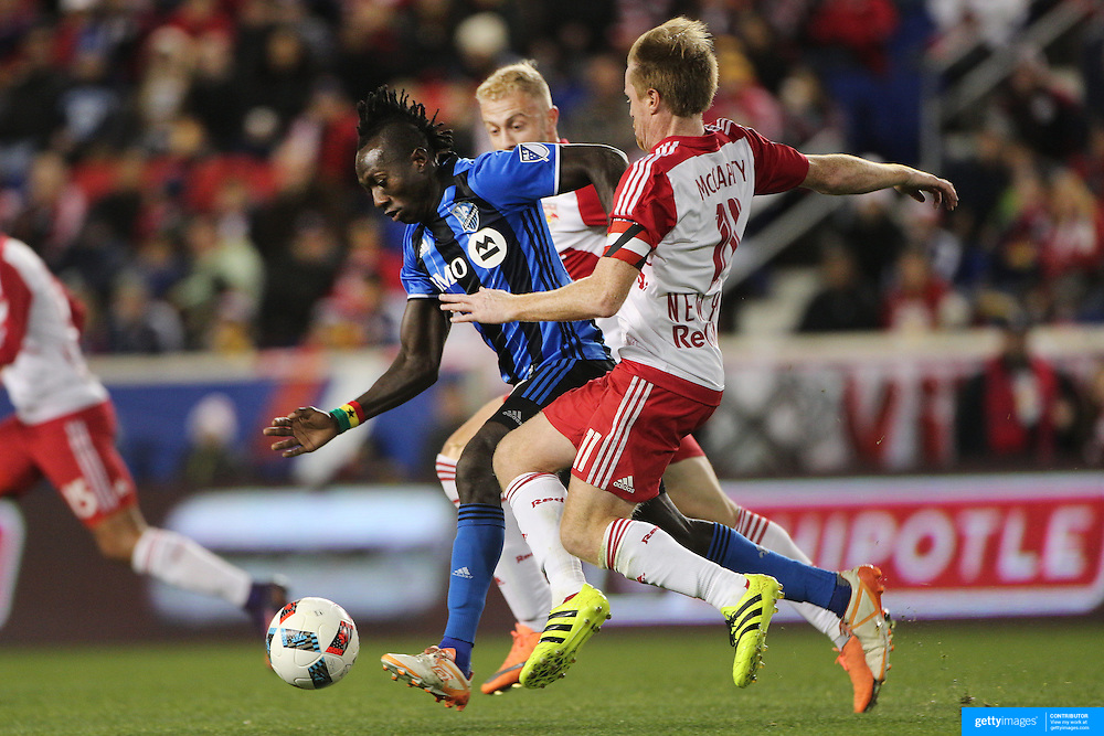 HARRISON, NEW JERSEY- November 06:  Dominic Oduro #7 of Montreal Impact is challenged by Dax McCarty #11 of New York Red Bulls during the New York Red Bulls Vs Montreal Impact MLS playoff match at Red Bull Arena, Harrison, New Jersey on November 06, 2016 in Harrison, New Jersey. (Photo by Tim Clayton/Corbis via Getty Images)