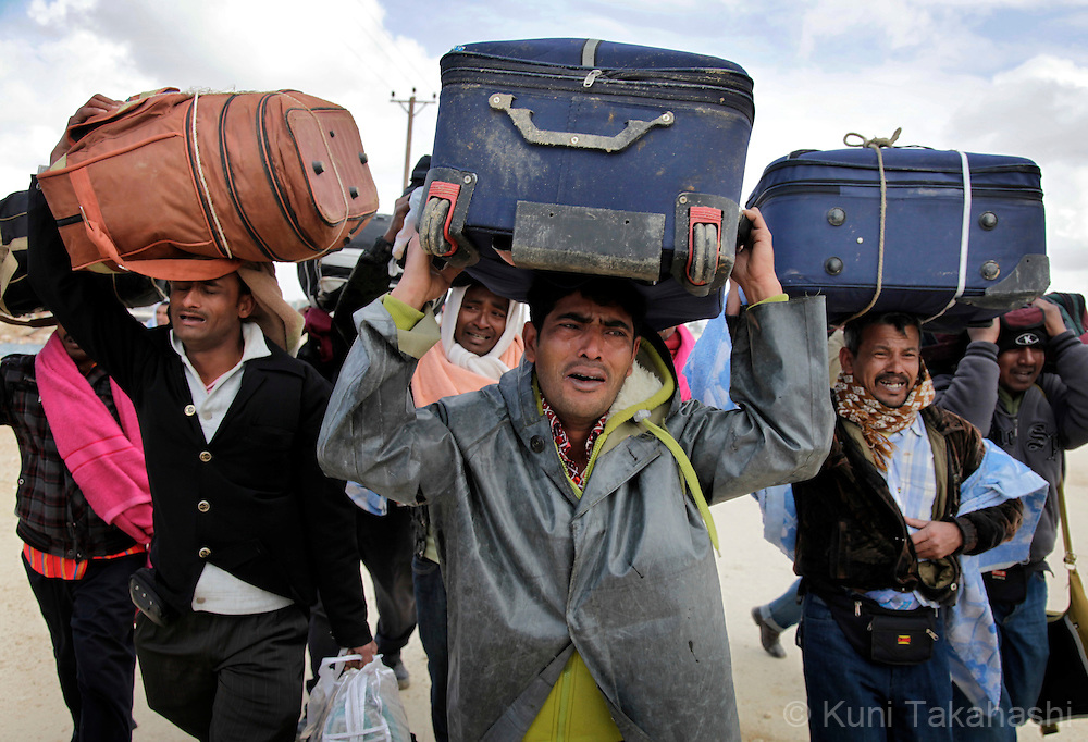 Migrant labors from Bangladesh emotionally walk back to their living compound after being rejected by Chinese evacuation ship at port in Benghazi, Libya, on Feb 26, 2011. Thousands of foreign workers are stranded in the country as security situation worsens. .Photo by Kuni Takahashi