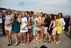 LIVERPOOL, ENGLAND - Friday, April 4, 2014: Racegoers from Birmingham during Ladies' Day on Day Two of the Aintree Grand National Festival at Aintree Racecourse. (Pic by David Rawcliffe/Propaganda)
