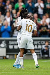 Goalscorers Bafetibis Gomis and Andre Ayew of Swansea City embrace - Mandatory byline: Rogan Thomson/JMP - 07966 386802 - 30/08/2015 - FOOTBALL - Liberty Stadium - Swansea, Wales - Swansea City v Manchester United - Barclays Premier League.